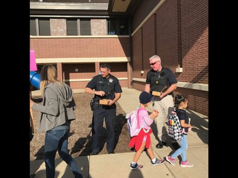 Highwood Officers Welcome OT students to school