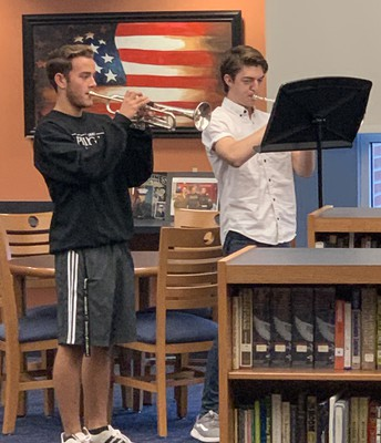SHHS Students Andy Pearce and Justin Hickerson Play Taps in Memory of Those Who Gave the Ultimate Sacrifice