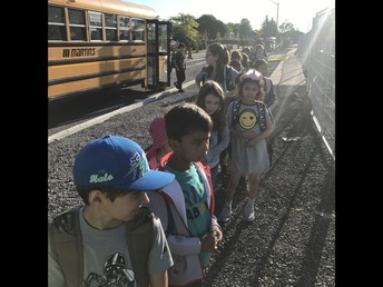 Students arrive safely at the new bus drop off location