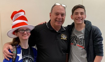 Shown with Mr. Northrop on his last day, are students Sara Palur wearing a Cat in the Hat cap, and Garrett Brammer.