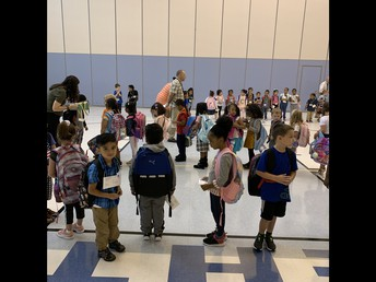 Eager Kindergarten students arrived and got into their groups with the help of staff