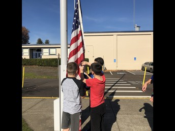 Students raise and lower the flag each day...