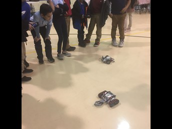 Students learning to use Robotics