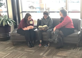 Reading to Employees at Mercy