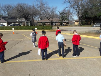 Second Grade students tracking their shadows