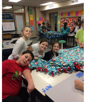 Students helping to make more blankets