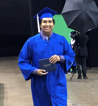 Adam Salas with his diploma
