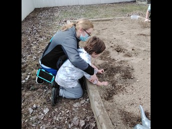 Pulling weeds, and digging a little!