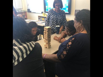 AYES Staff building community by playing Jenga