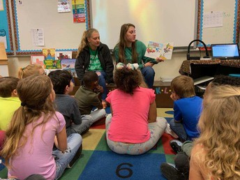Brenham High School athletes begin Readers and Greeters program at elementary campuses
