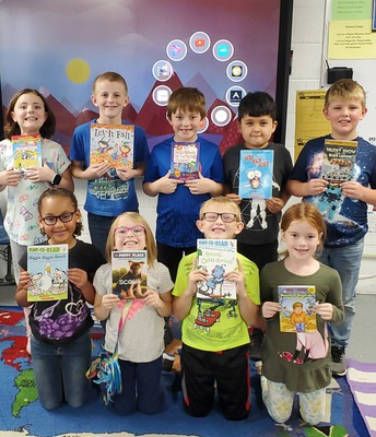 2nd Grade with their monthly book!