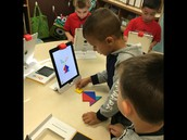 Students learning to use the IPAD as an educational tool