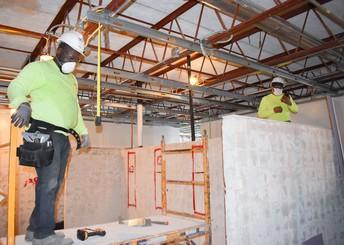 Contractors doing interior work at a school