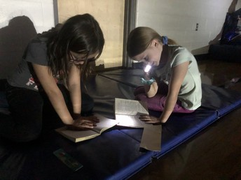 """Reading in the gym on """"Flashlight Friday"""""""