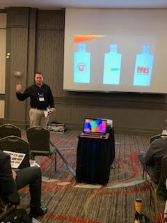 Andy Wise presenting at 2019 conference.