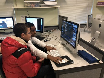 Bulletin Students working on editing, creating in I-Movie