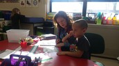Mrs. Jarvis and Tyrone work on math together!