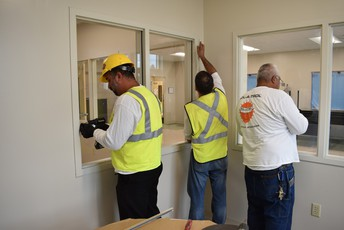 a photo pf contractors installing windows inside of the Charles W. Flanagan High School New Classroom Building