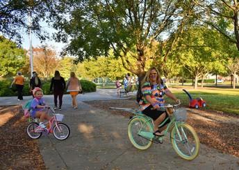 students riding bikes to school