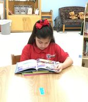 Katelynn enjoys her book.