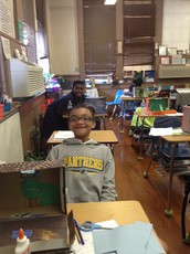 4th Grader's Complete a Project on Ecosystems