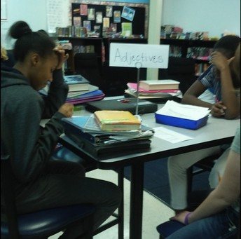 8th Grade Scholars Erynn and Miriam hard at work