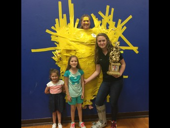 Coach Karg is always happy to win a trophy, and even happier to help kids however she can!