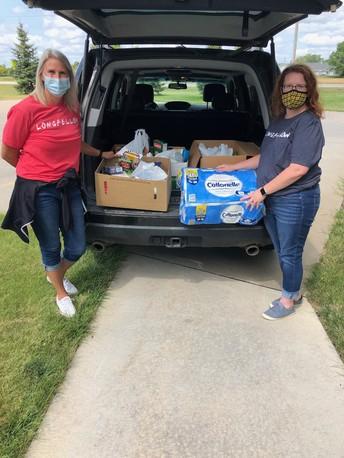 Longfellow teachers/staff give back