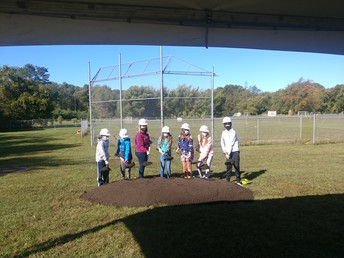 5th Grade Students and PTO President Christy Renn Are The First to Break Ground!