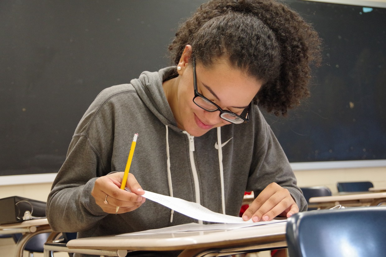 High school student engaged in her work during summer school.