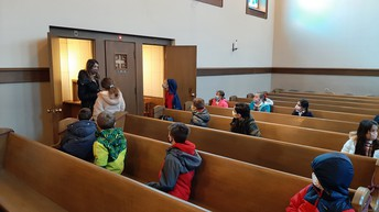 Mrs. Kelley helps students understand items used in the Sacrament of Reconciliation