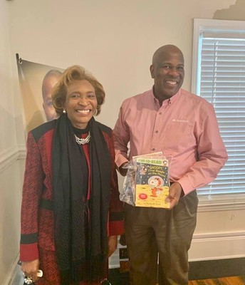 Dot Guthrie With Anthony Gallant, CEO of Gallant State Farm Insurance With a Literacy Pack