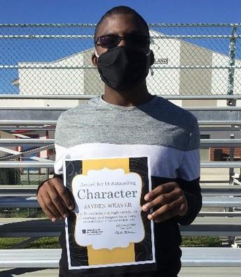Jayden holding his Character certificate