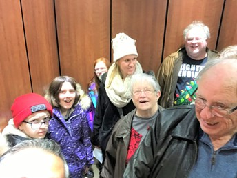 Up the elevator to go caroling !