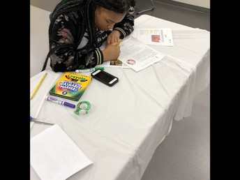 Carver Student working diligently at the CCPS Steam Fair!