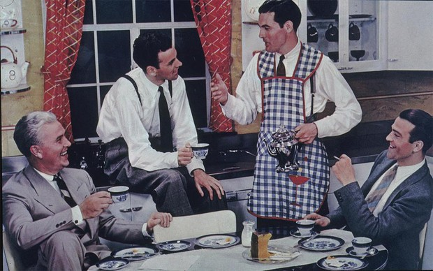 Four men drinking coffee around a kitchen table. They look like they belong in Mad Men.