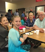 Grandparents spend quality time at PTA breakfast.