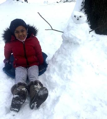 Genesis Cordero-Perez with her snow friend...😃