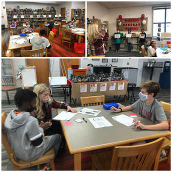 students working at tables with Paine teachers