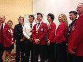 Samantha Martin (third from right) poses with the new Skills USA board