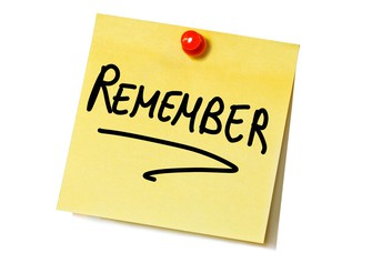 Icon of a post it note that says remember.