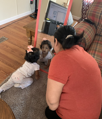 Amelia, 23 months old, and mom, using 'mirror time' to name body parts