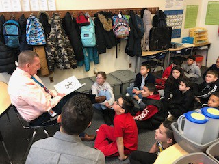 Mr. Frizelle reads to Mr. Ferreira's class
