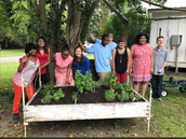 Students learn planting skills at Ella's