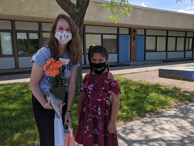 Teacher and student wearing their masks.