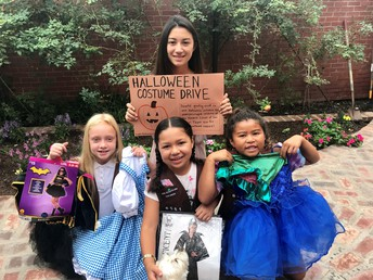 Girl Scouts collecting Halloween costumes