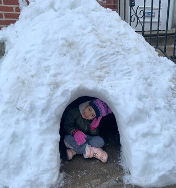 Cyniah Otero hanging out in the igloo she built 🧊
