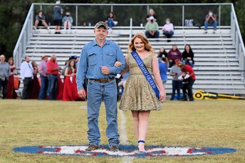 Vanessa Kissler - Reigning Miss Mountainburg and Dragon Homecoming Queen, escorted by her dad, Lee Seratt.
