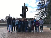 Eagle Scholars pose in front of Sparty