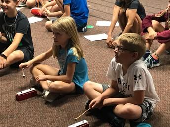 Fifth graders practice the bells!